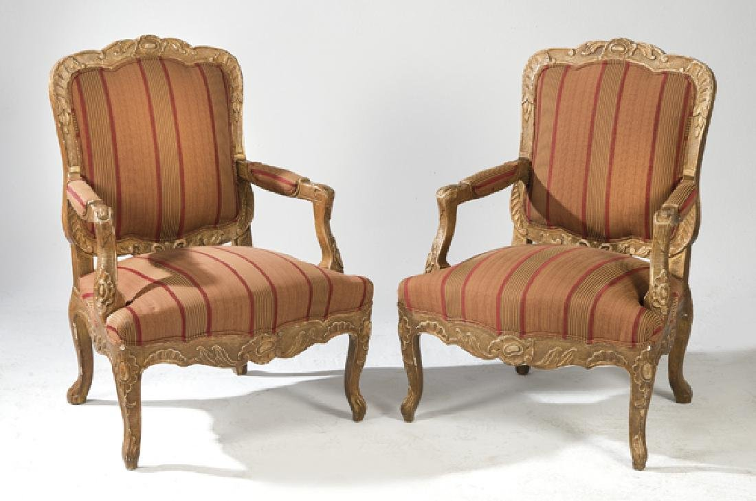 Pair of carved, golden wood Louis XV style armchairs,