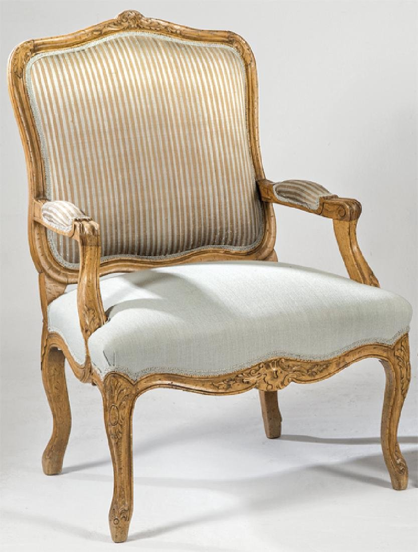 Armchair made of carved walnut wood, Louis XV style,