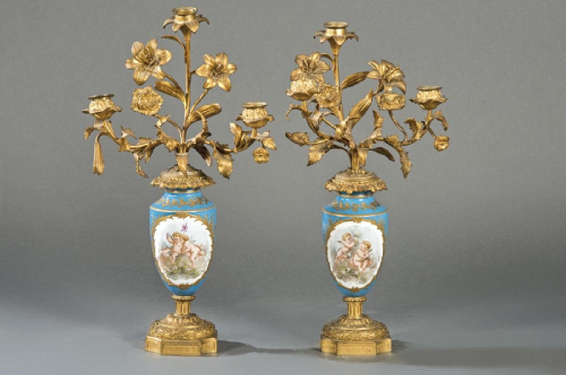 Pair of French candle holders in porcelain and bronze,
