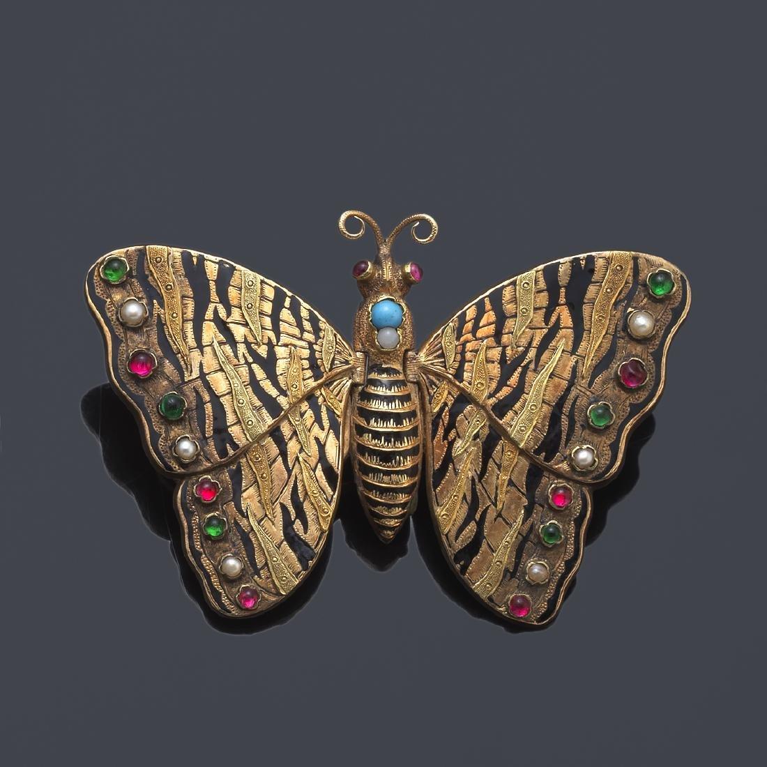 Butterfly-shaped locket brooch in 14K yellow gold.
