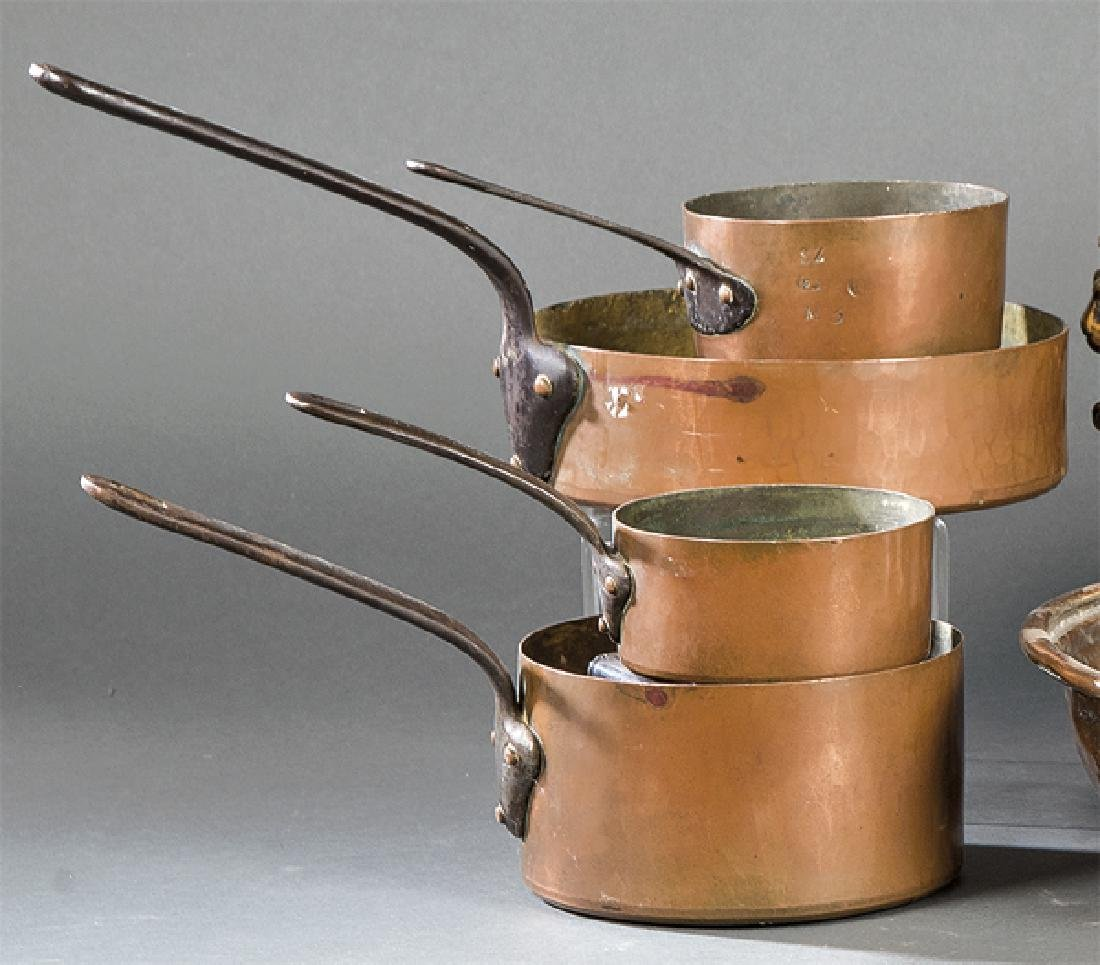 Set of four casserole pots in copper and iron, late
