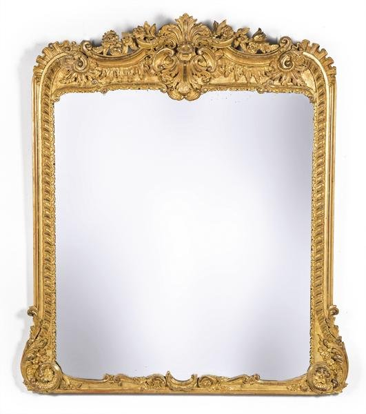 Louis XV mirror frame in carved and gilded wood.