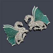 Two delicate brooches with a pair of rampant dragons