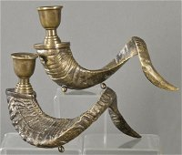 Pair of bronze candlesticks in the shape of a mountain