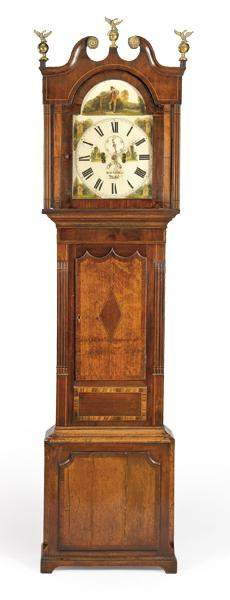 George III tall case clock in carved oak and mahogany