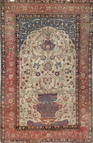 Persian carpet in wool and silk.   With a central vase
