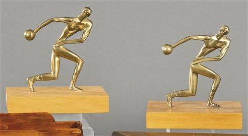 """Pair of bronze and wood bookends, """"Athletes"""" h. 1970."""