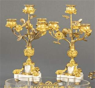 Pair of gilt bronze and white marble candlesticks,