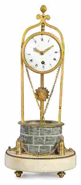 Louis XVI clock, on a round white marble plinth there