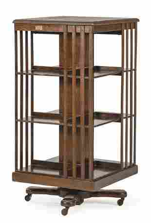 Revolving bookcase in mahogany wood. With Mac Kain