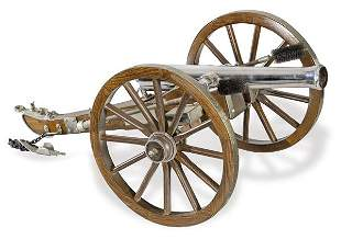 """Wooden and metal cannon with dedication and date """"The"""