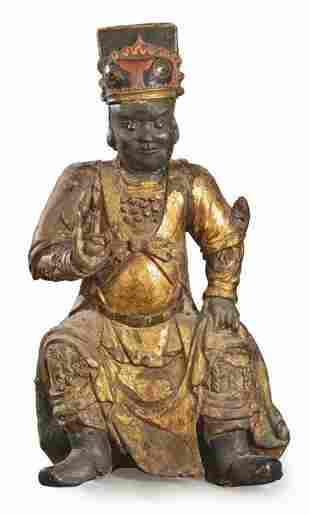 Chinese dignitary in carved, polychrome and gilded