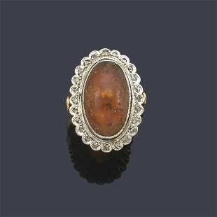 Ring with amber in cabochon with a border of rose-cut
