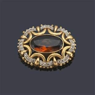 Oval cut citrine quartz brooch of approx. 6.12 ct set