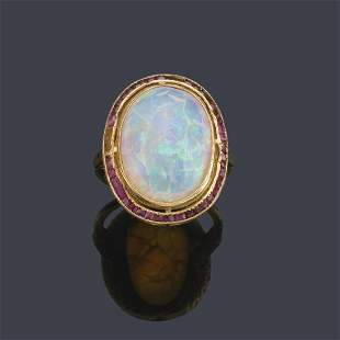 Cabochon opal ring with calibrated ruby 