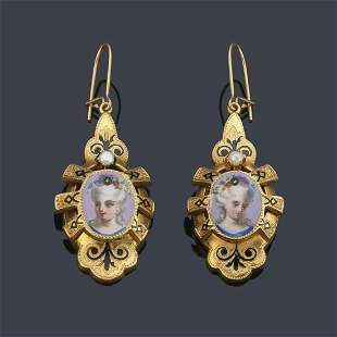 Long earrings with a female face painted by hand on a