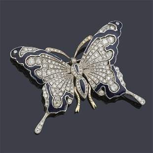 Butterfly-shaped brooch with diamonds and blue enamel.