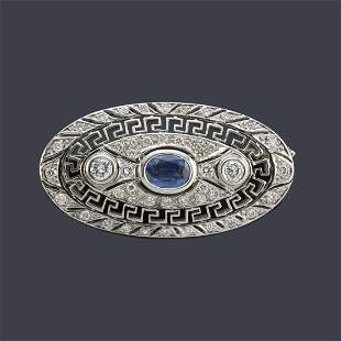 Art deco' style brooch with a central oval cut sapphire