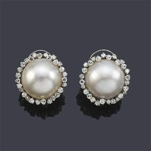 Short earrings with a pair of Mabe pearls and a border