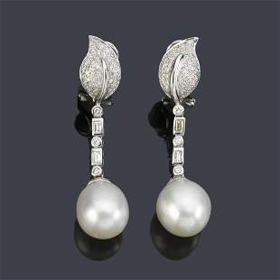 Long earrings with a pair of pearled pearls with
