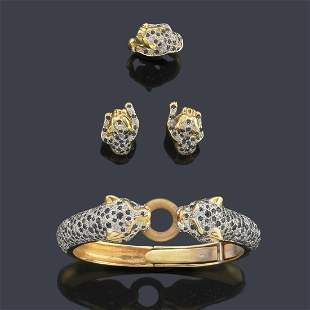 Set of bracelet, earrings and ring with motifs in the