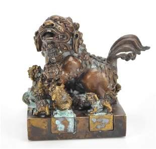 7 Interlocking Bronze Chinese Lion Seals20th C