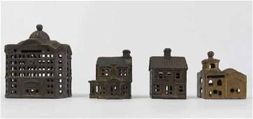 FOUR CAST-IRON BUILDING BANKS