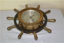 Brass Chelsea ships clock set in brass ship wheel