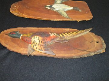 Pair of Rangeley Maine carved ducks on wooden plaques