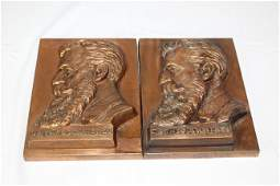 Two matching bronze plaques