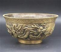 A GILT BRONZE CARVED DRAGONS BOWL QIANLONG MARK 17THC