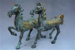 A PAIR BRONZE GILDED HORSE STATUE MING DYNASTY.