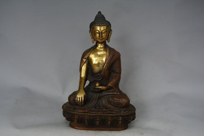 A GILT BRONZE SHAKYAMUNI BUDDHA FIGURE MING DYNASTY.