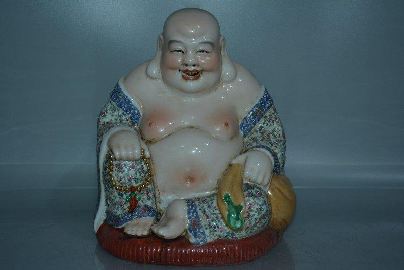 A PORCELAIN ENAMEL BUDDHA FIGURE QING DYNASTY 17TH/C.