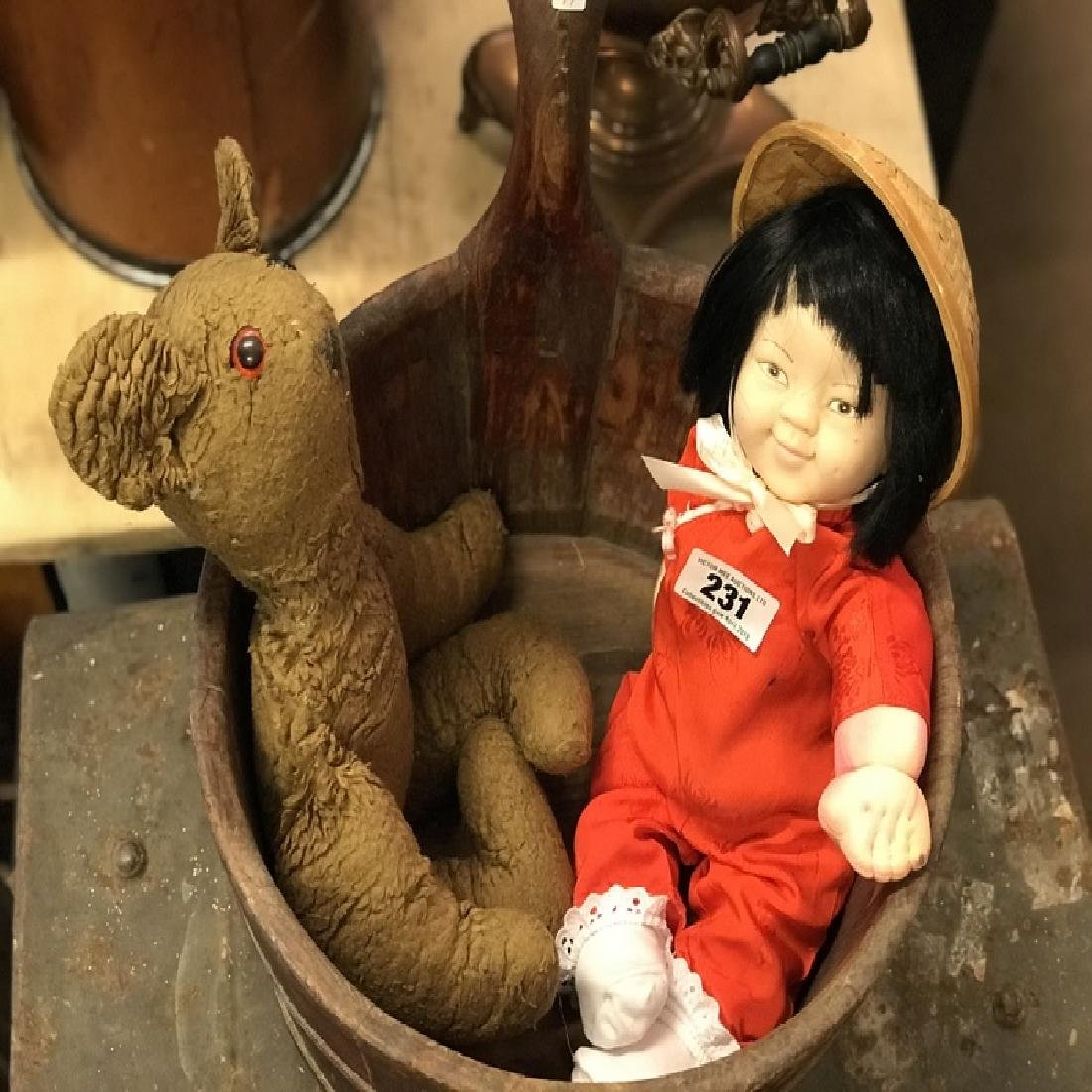 Vintage child's teddy bear and doll.