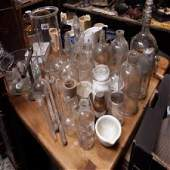 Large collection of glass scientific beakers and