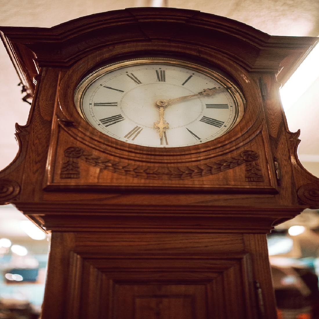 Late 18th C. carved oak long cased clock with original