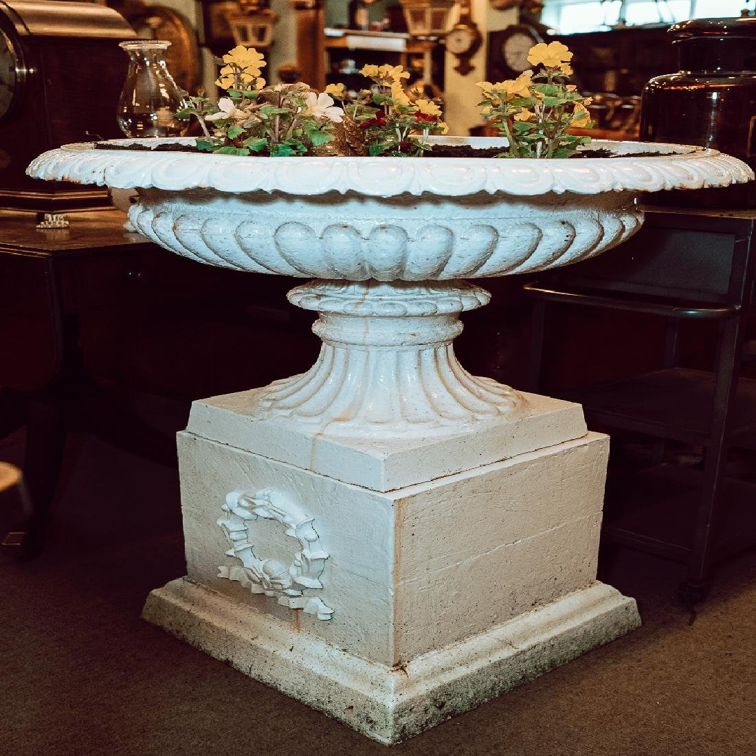 Pair of exceptional cast iron garden urns on pedestals.