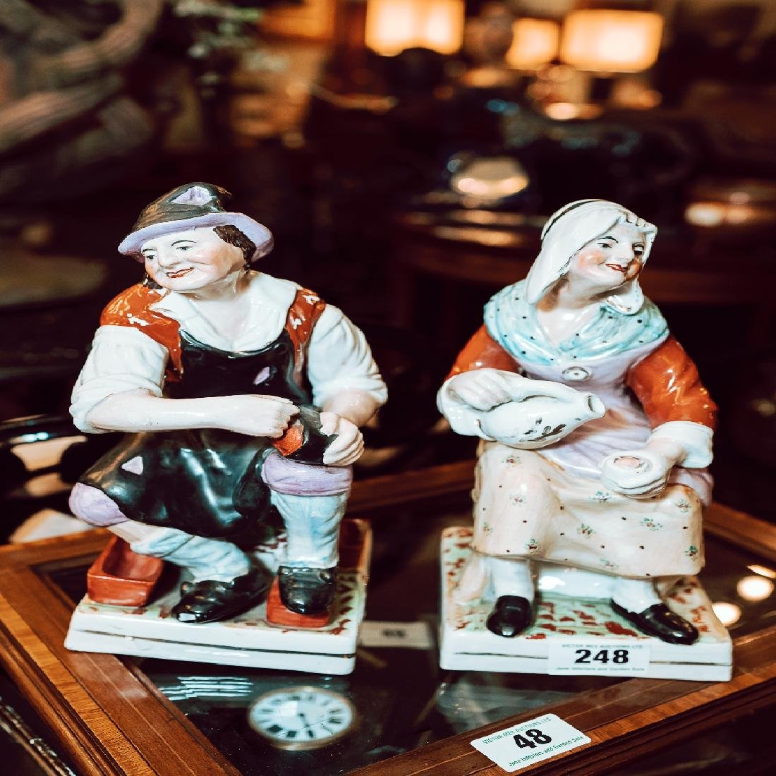 Pair of ceramic figures the Cobbler and his Wife.