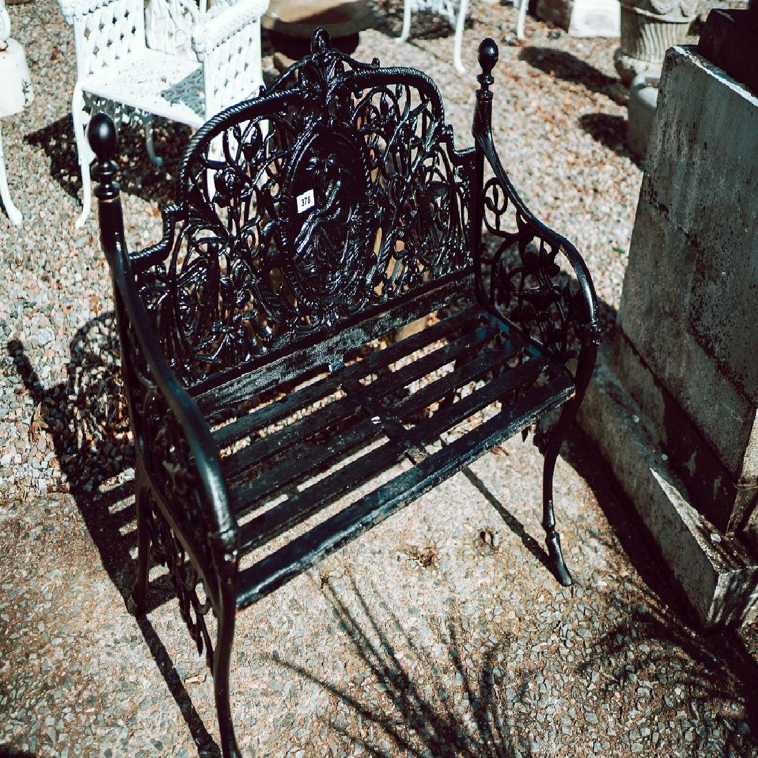 Decorative cast iron garden bench.