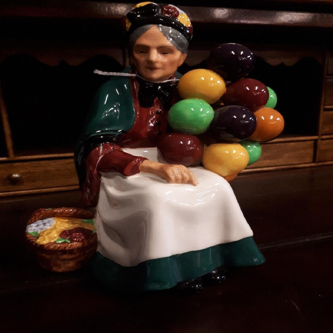 20th. C. Royal Doulton figurine Old Balloon Seller, HN