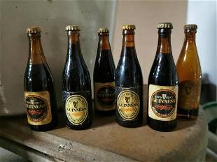 Six Miniature Guinness Bottles