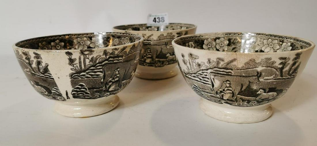 Three 19th. C. brown and white bowls with cow scenes.