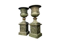 Pair of exceptional quality cast iron urns.