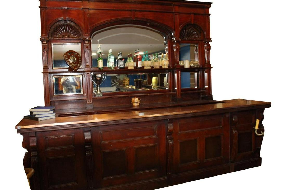 Victorian mirrored bar back and carved mahogany counter