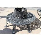 Decorative cast iron tree surround garden bench.