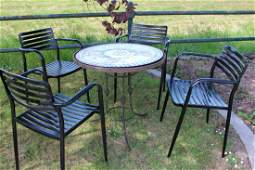 Wrought iron garden table and four metal garden chairs