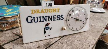 Rare Draught Guinness Penguin electric clock.