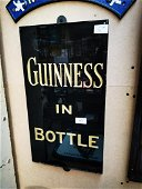 Guinness In A Bottle slate advertising sign.