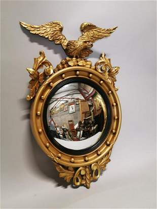 19th C. carved giltwood convex mirror.